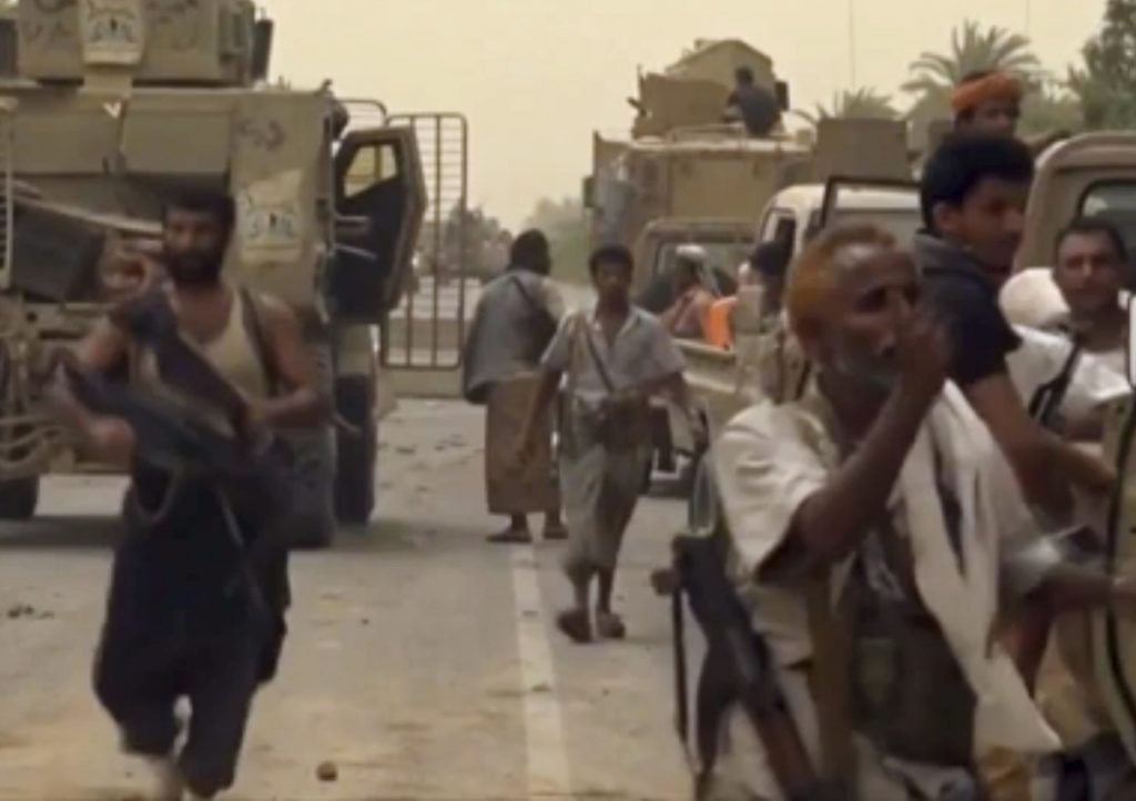 This still image taken from video provided by Arab 24 shows Saudi-led forces gathering to retake the international airport of Yemen's rebel-held port city of Hodeida from the Shiite Houthi rebels Saturday.