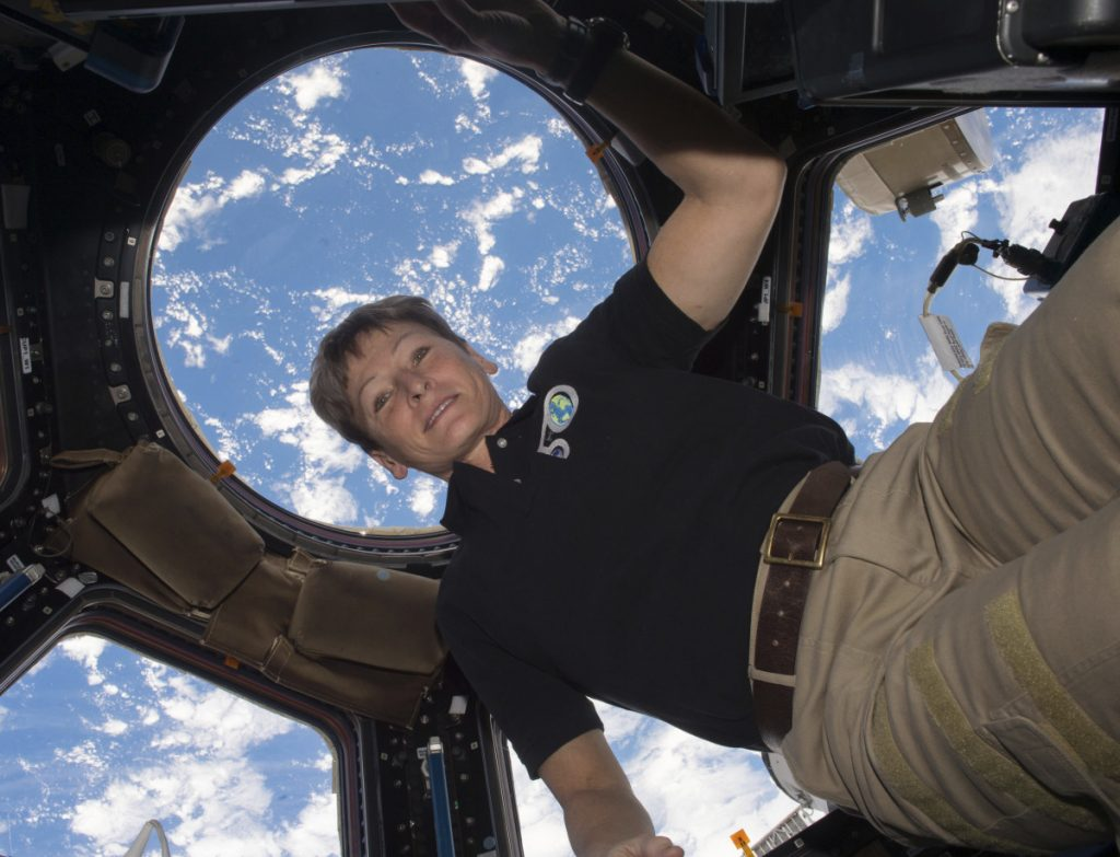 Astronaut Peggy Whitson is shown on the International Space Station, with the Earth in the background, in 2016.