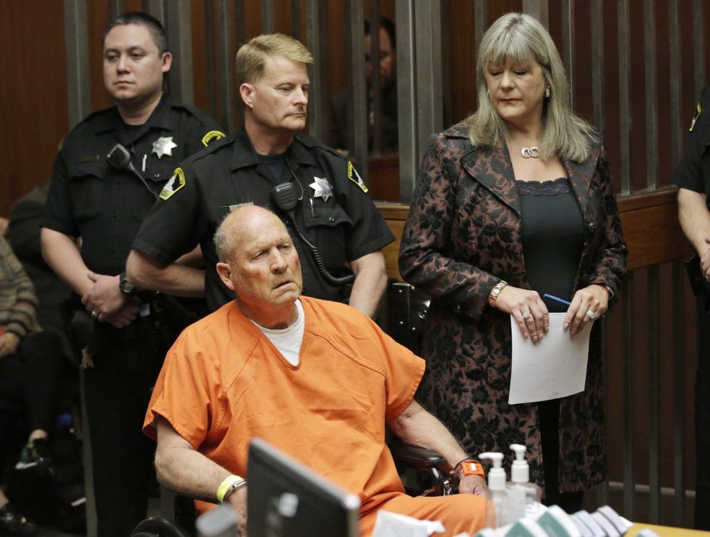 Joseph DeAngelo, 72, who authorities suspect is the so-called Golden State Killer responsible for at least a dozen murders and about 50 rapes in the 1970s and '80s, is accompanied by Sacramento County Public Defender Diane Howard, right.