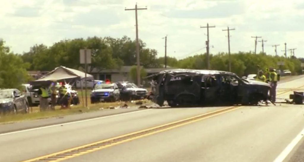 Video provided by KABB/WOAI in San Antonio shows the scene where authorities say at least five people were killed when an SUV carrying more than a dozen people crashed in Big Wells, Texas, while fleeing from Border Patrol agents.