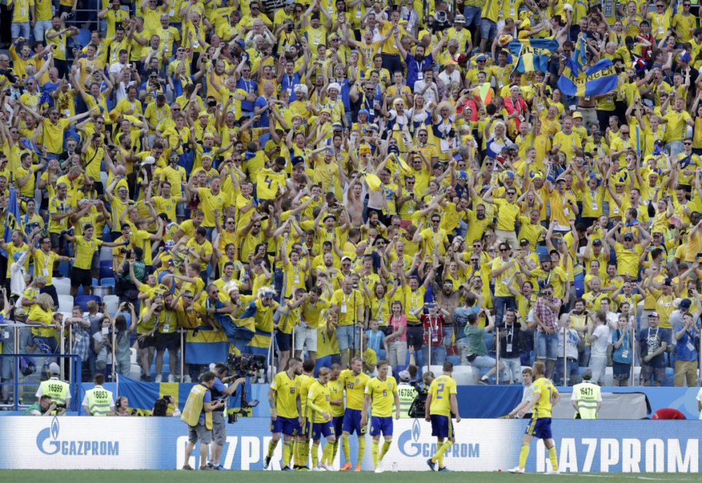 Sweden's Andreas Granqvist, center, celebrates with his teammates after converting a penalty kick in the 65th minute on Monday. Sweden held on to defeat South Korea, 1-0.