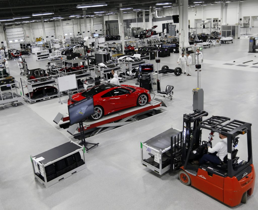 Technicians work on Honda Acura's next-generation supercar, the NSX, at its Performance Manufacturing Center in Marysville, Ohio. If President Trump delivers on threats to slap 25 percent tariffs on imported automobiles and parts, experts say it will cut auto sales and cost jobs in the U.S., Canada and Mexico.