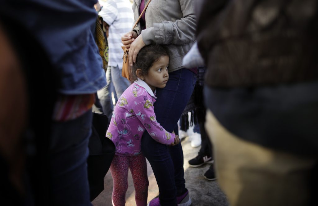 Nicole Hernandez, of the Mexican state of Guerrero, holds her mother June 13 as they wait in Tijuana to request political asylum in the U.S. A reader says separating children from their immigrant parents at the border is not required by law.