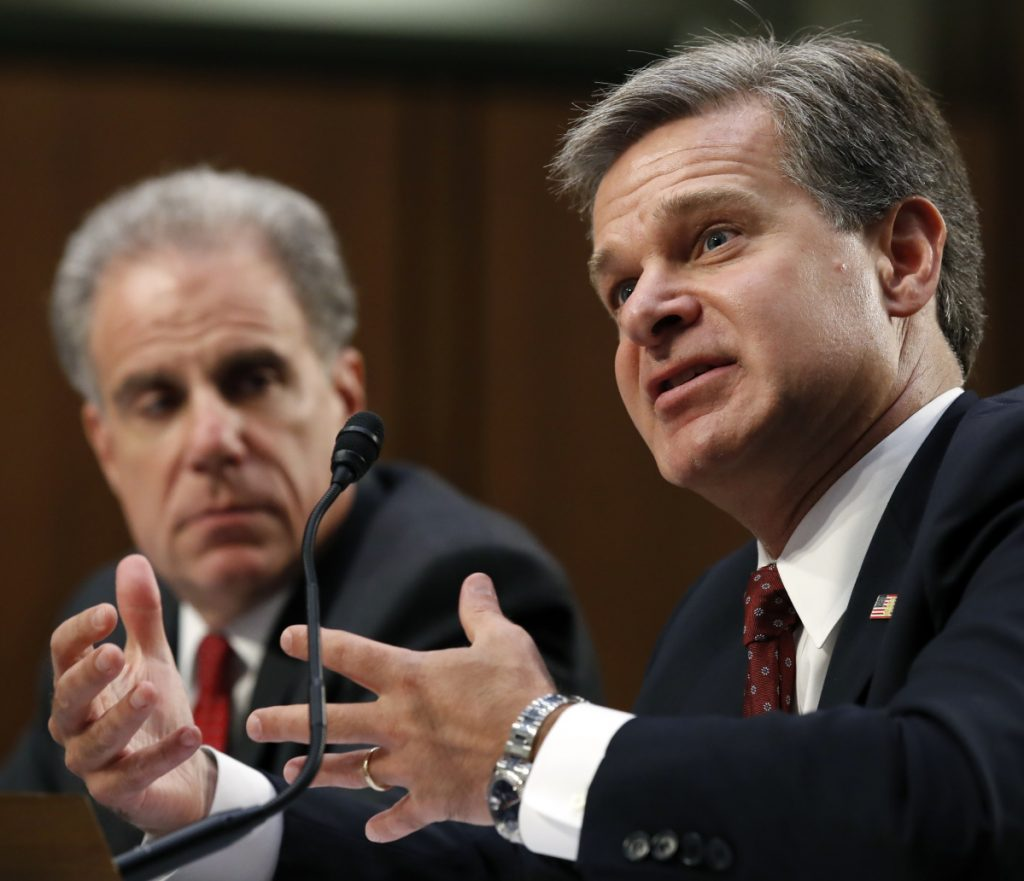 Department of Justice Inspector General Michael Horowitz, left, and FBI Director Christopher Wray testify Monday during a hearing of the Senate Judiciary Committee.