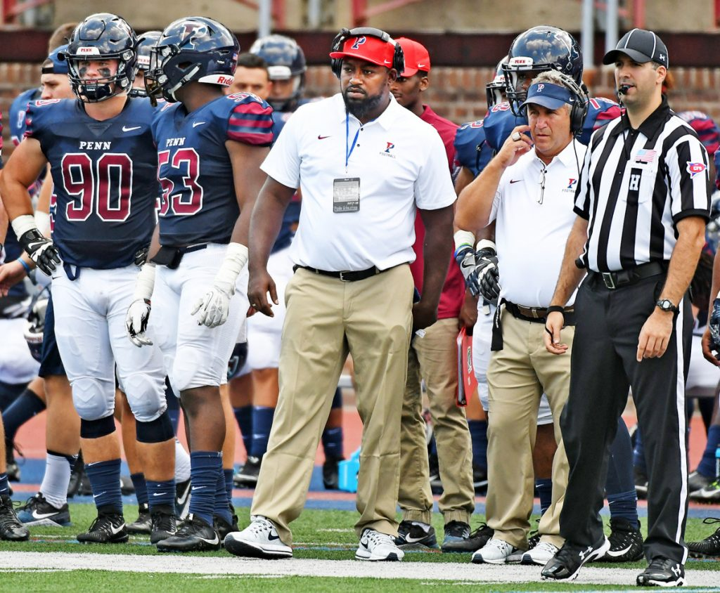 Malik Hall, center, spent three seasons as the defensive line coach at the University of Pennsylvania before being hired as the 20th head football coach in Bates College's history on Monday. (University of Pennsylvania)
