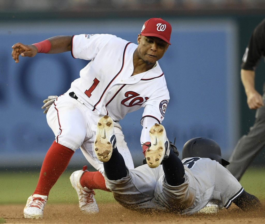 Didi Gregorius of the Yankees is tagged out by Nationals second baseman Wilmer Difo on a stolen-base attempt during New York 4-2 win in the second game of a doubleheader Monday night.