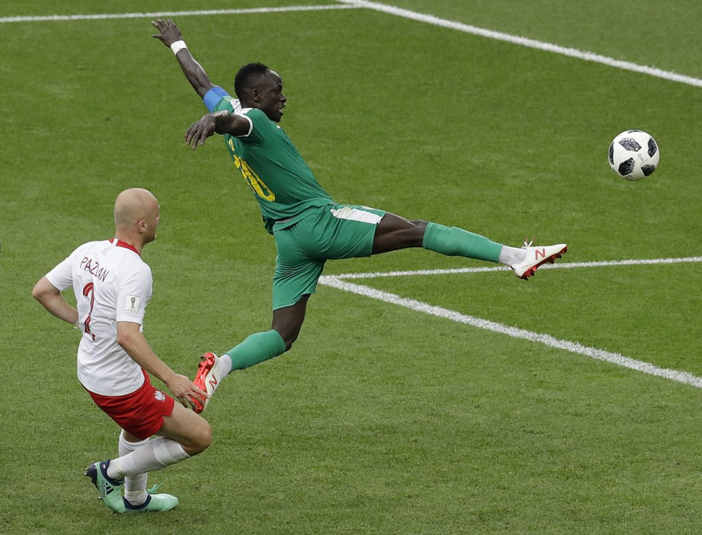 Senegal's Sadio Mane, right, and Poland's Michal Pazdan challenge for the ball during their match at the 2018 soccer World Cup in the Spartak Stadium in Moscow on Tuesday. Senegal won, 2-1.