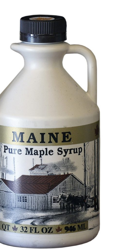 """DAYTON, ME - MAY 30: Maine Maple Syrup on the shelf at Harris Farm in Dayton Wednesday, May 30, 2018.  Some Maine maple producers (this photo is not from a producer in story) are upset by impending FDA regulation that says the Nutrition Facts label on syrup (and honey) must say that syrup as """"added sugar.""""(Staff photo by Shawn Patrick Ouellette/Staff Photographer)"""