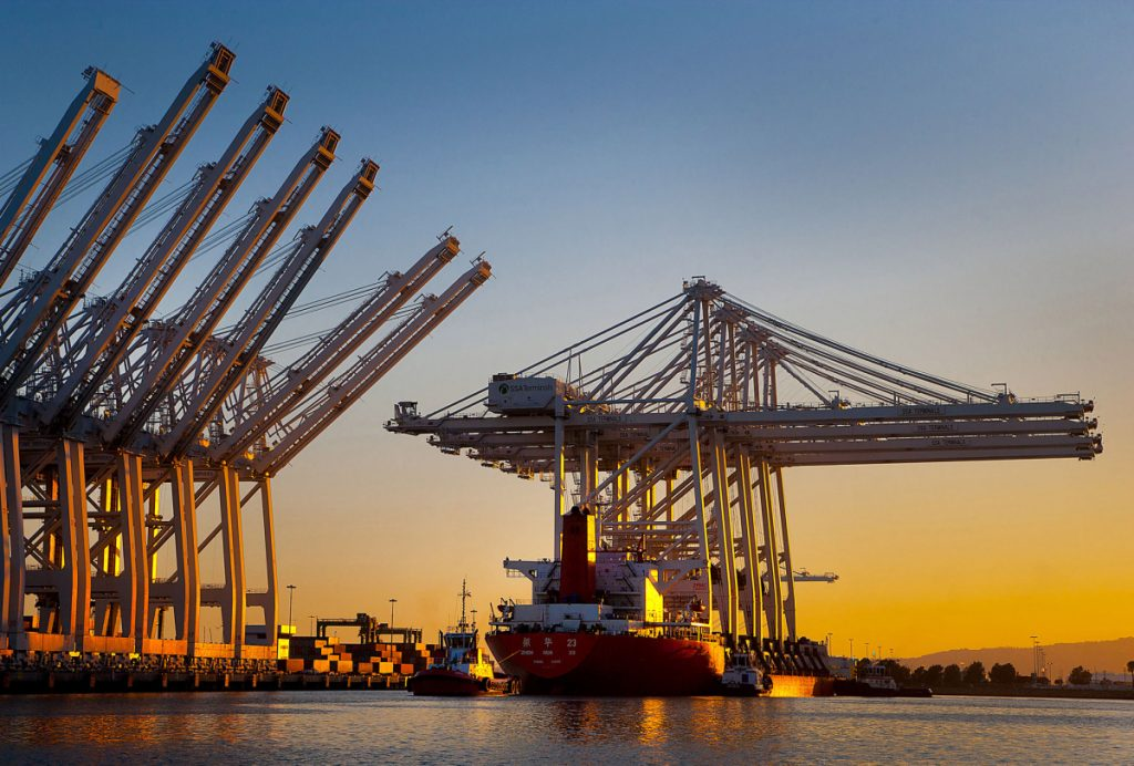 New container cranes from a Chinese heavy industry company are delivered by ship to the port of Long Beach, Calif., in 2012.