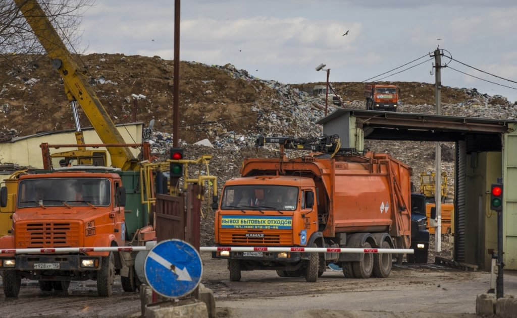Garbage trucks leave the Volovichi landfill near the town of Kolomna, south of Moscow, after depositing their loads. Residents are blaming rotting trash from Moscow for respiratory problems and skin rashes that they say are caused by foul air and poisonous gases.