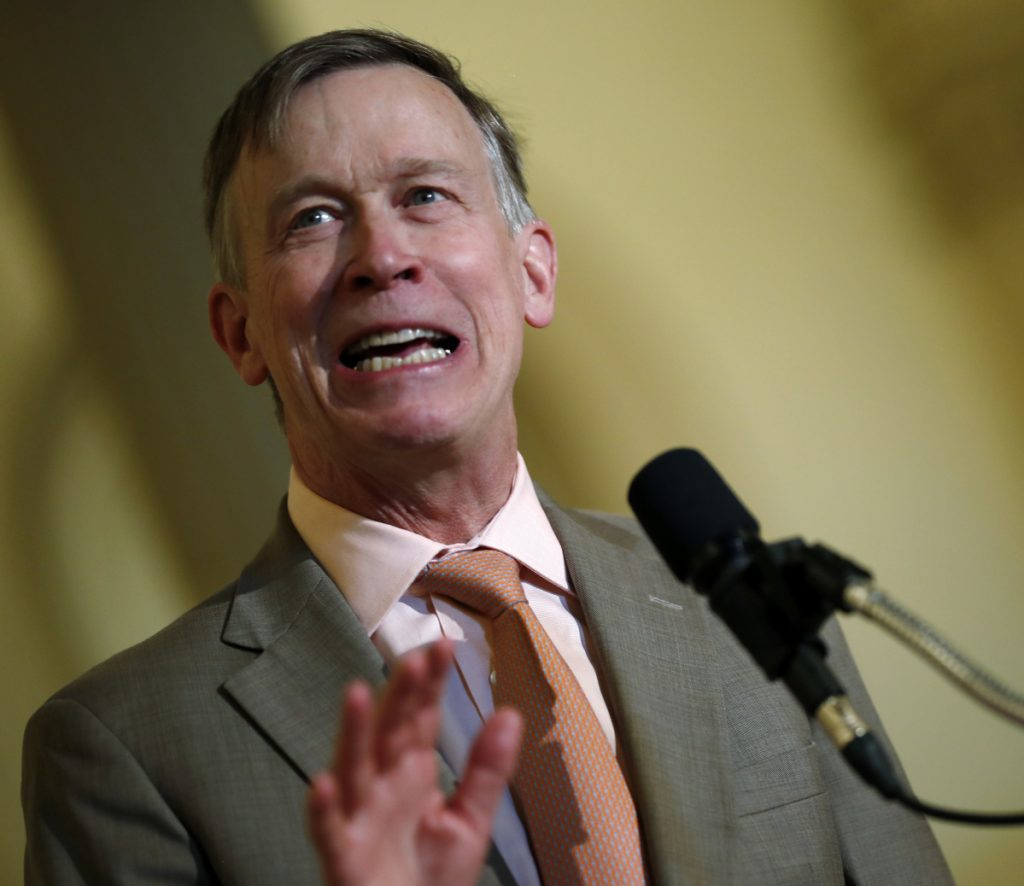 Colorado Gov. John Hickenlooper speaks at the state Capitol in May. On Tuesday, Hickenlooper ordered state regulators to adopt California's vehicle pollution rules, joining other states in resisting the Trump administration's plans to ease up on emissions standards.