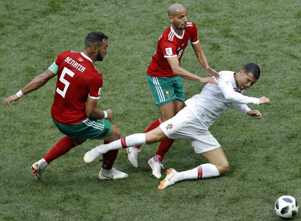 Morocco's Mehdi Benatia, left, and Morocco's Karim El Ahmadi, center, challenge for the ball with Portugal's Cristiano Ronaldo, right, during the group B match between Portugal and Morocco at the 2018 soccer World Cup in Moscow on Wednesday. (AP Photo/Victor Caivano)