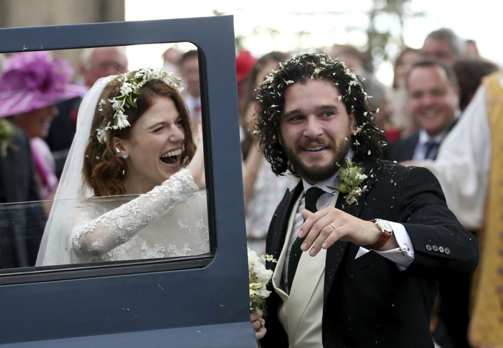 Actors Kit Harington and Rose Leslie leave the Rayne Church in Aberdeenshire, Scotland, after their wedding ceremony Saturday.