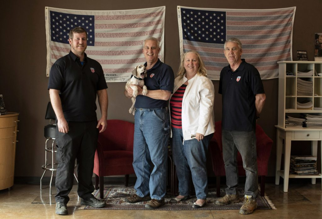 "The team at Honor Defense, a gunmaker outside Atlanta, includes owner Gary Ramey, second from left, who says two credit card processing companies refused his business because of what Honor Defense makes and sells. Ramey said the companies shouldn't be ""infusing politics into business."""