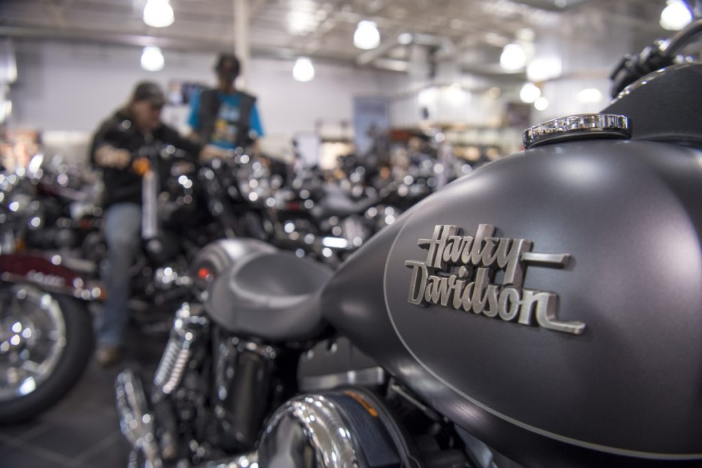 The Harley-Davidson logo is seen on the fuel tank of a motorcycle on display at the Oakland Harley-Davidson dealership in Oakland, Calif.