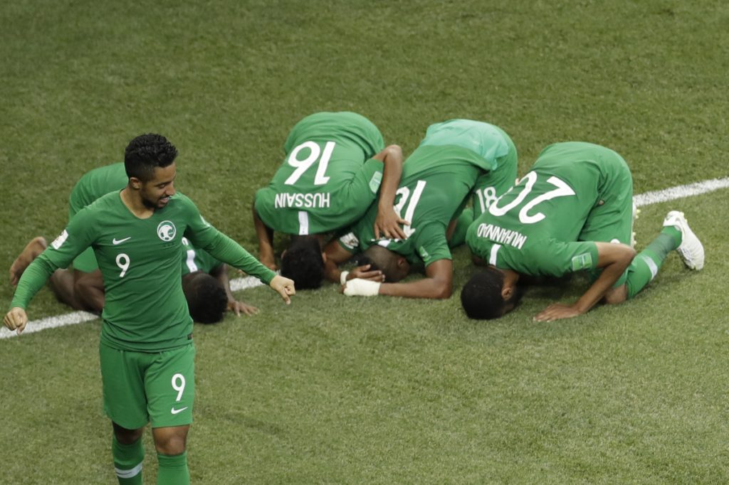Saudi Arabia's Salem Aldawsari , second from right, celebrates with teammates after he scored his side's winning goal during their match against Egypt at the 2018 World Cup on Monday. Saudi Arabia won 2-1.