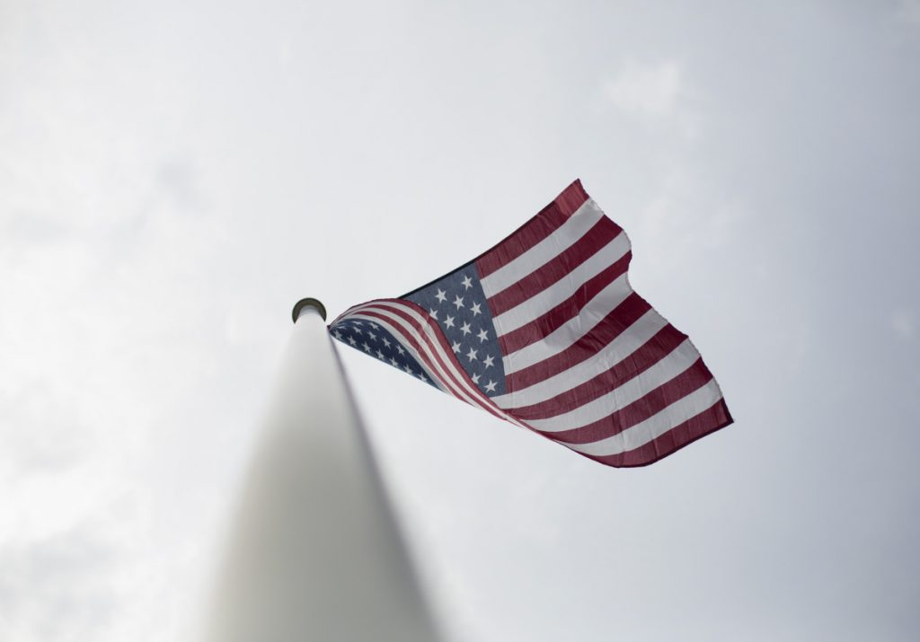 Visible from Ellen Peoples' garage, the American flag flaps in a breeze Wednesday. Peoples' son Alan says having a new flag and a place to fly it from remains an important part of his mother's life.