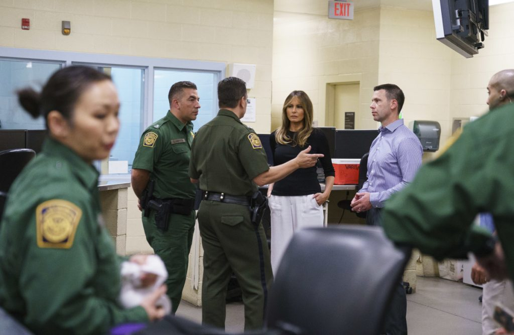 First lady Melania Trump talks with border patrol agents as she visits a processing center of a U.S. Customs and border and protection facility in Tucson, Arizona, on Thursday.