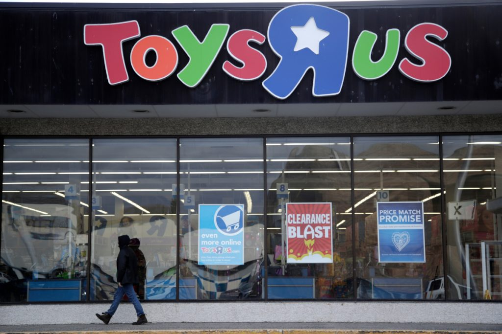 A person walks near the entrance to a Toys R Us store in Wayne, N.J., in January. Toys R Us is closing its last U.S. stores by Friday, after poor sales during the holiday season.