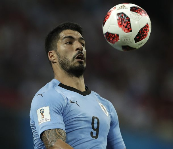 Uruguay's Luis Suarez controls the ball during Saturday's match with Portugal at Sochi, Russia. Uruguay won, 2-1.