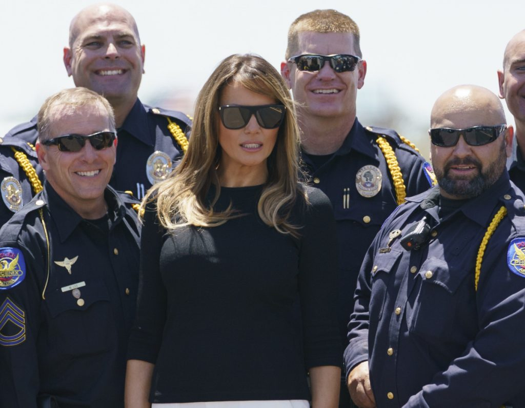 First lady Melania Trump takes a picture with members of law enforcement at Sky Harbor International Airport in Phoenix on Thursday en route to Washington.