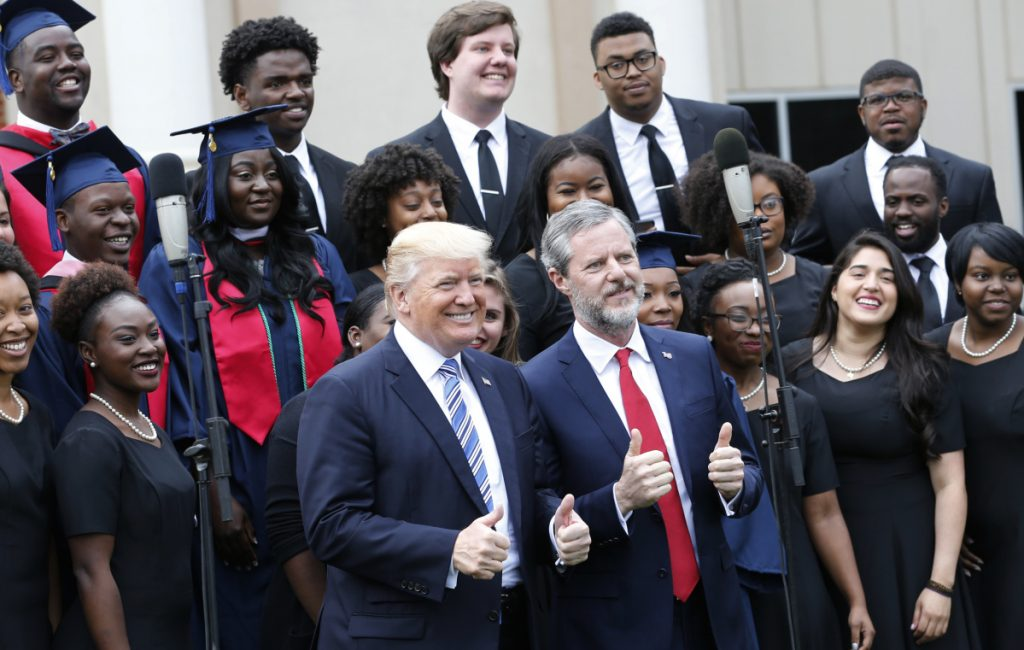 President Trump poses with Liberty University president, Jerry Falwell Jr., in front of a choir during commencement ceremonies at the school last year in Lynchburg, Va. Trump's next court pick will likely lead to a reversal in Roe v. Wade.