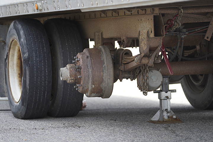 One of the rear axles of this trailer was damaged when the truck struck the toll booth.