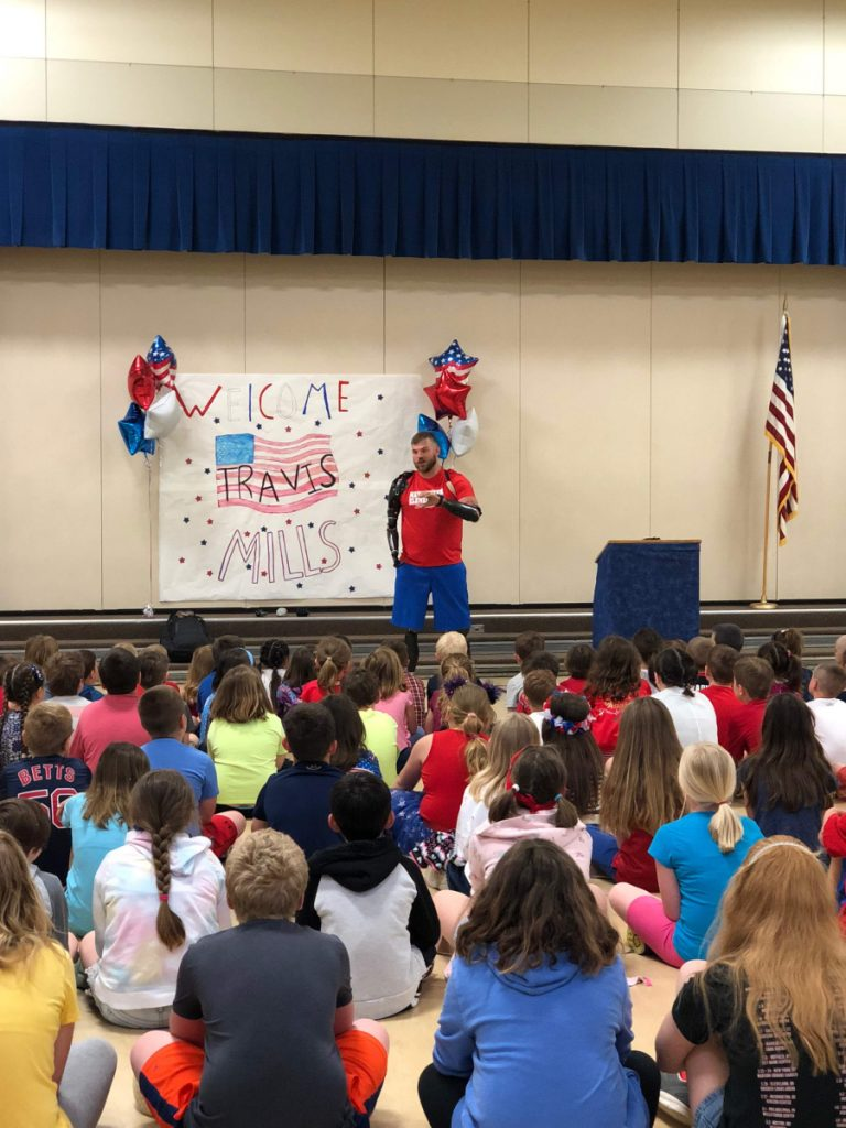 Travis Mills speaks May 23 to students and staff at Manchester Elementary School.