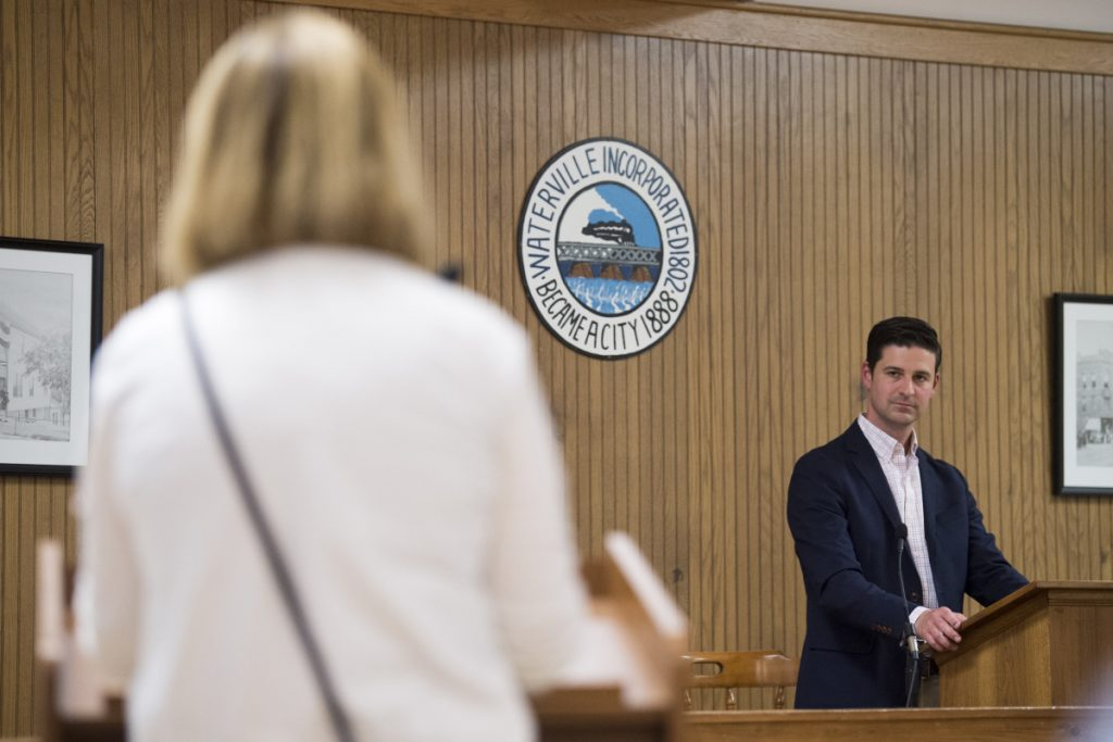Hilary Koch, left, speaks out against remarks made on social media by Mayor Nick Isgro, right, during community notes at the City Council Chambers at The Center on May 15.