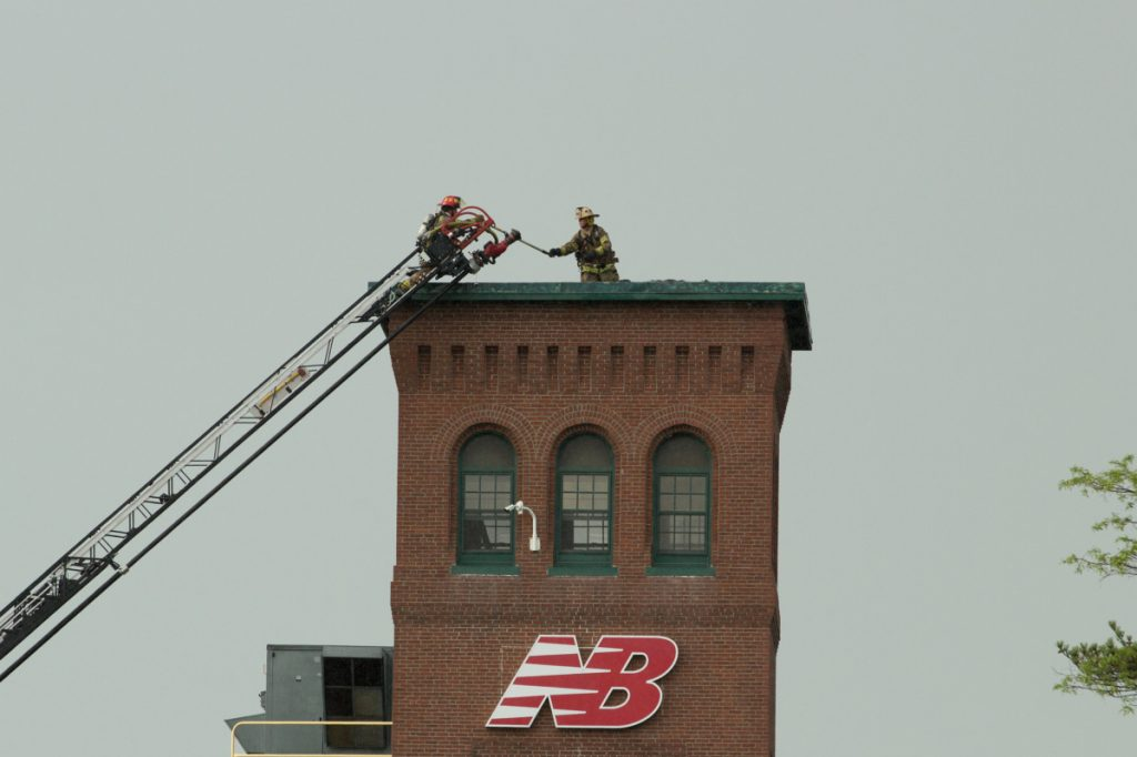 Firefighters battle a fire at the New Balance factory in Skowhegan on Friday.