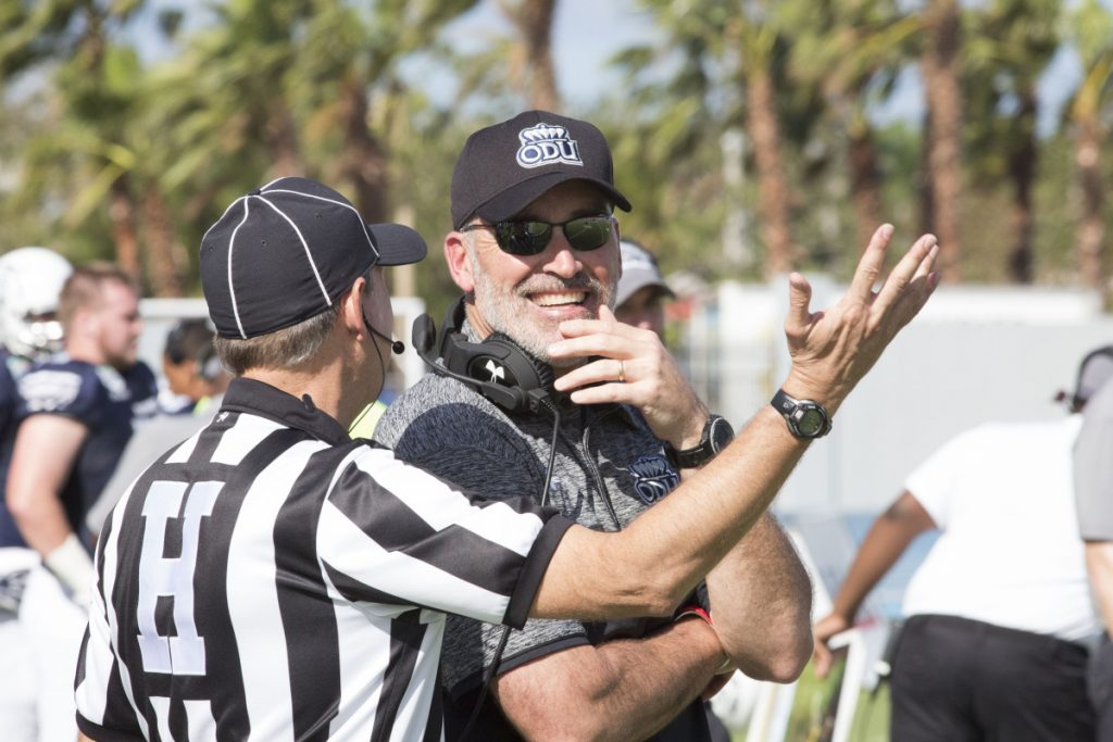 Old Dominion coach Bobby Wilder laughs with an official during the first half of the 2016 Bahamas Bowl against Eastern Michigan.