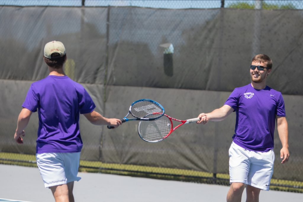 Waterville's doubles teammates Ben Danner (left) and John Evans congratulate one another during a doubles match against Ellsworth in the Class B North semifinals Saturday afternoon at Colby College in Waterville.