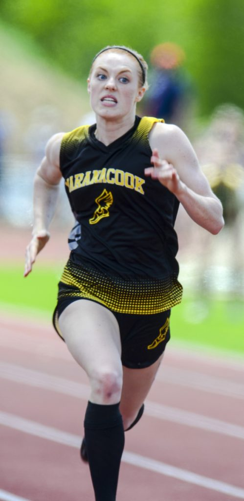 Staff photo by Joe Phelan   Maranacook's Janika Pakulski runs in the 100 meter dash during the Class C track and field state meet Saturday in Waterboro. Pakulski finished in 13.17 for second place.