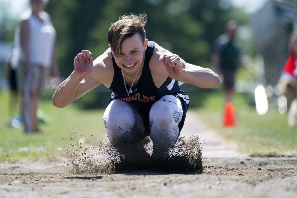 Winslow's Jake Warn competes in the triple jump at the Class B track and field state championships Saturday at Foxcroft Academy.