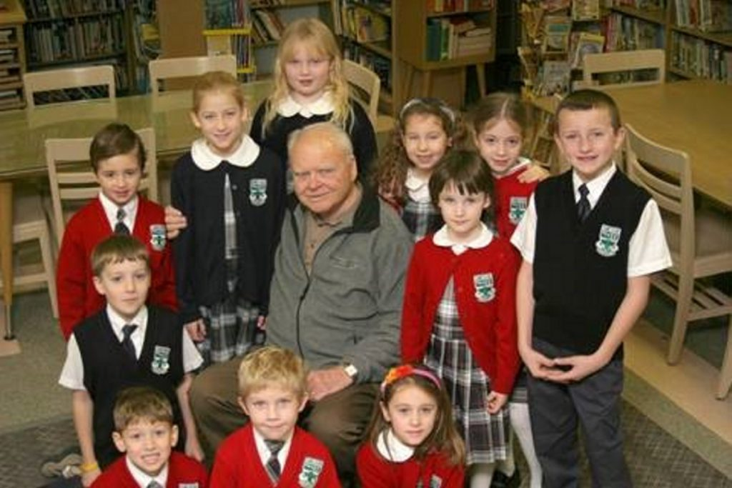 "Mount Merici Academy received a gift of $83,000 from a unitrust set up by Joseph Alfred ""Fred"" Boucher, pictured here surrounded by Mount Merici students. Boucher died in 2011 at the age of 88."