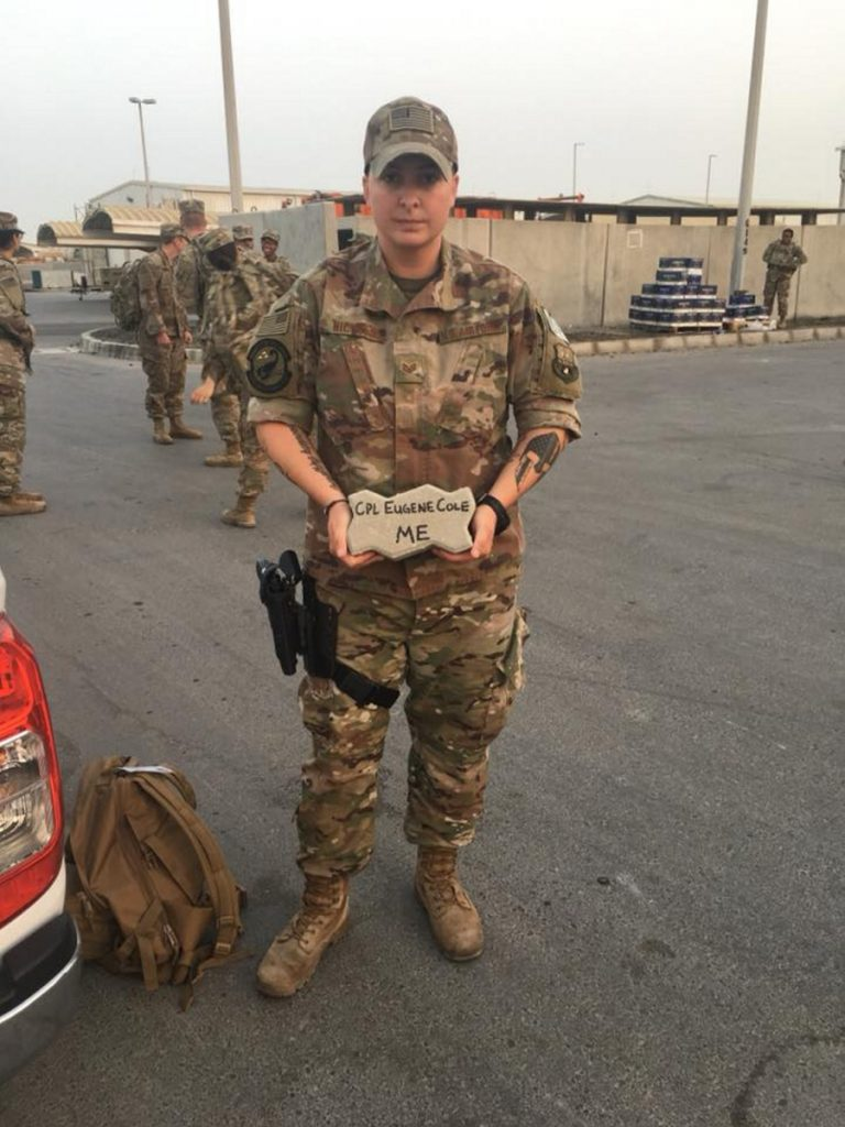 Katelyn Nichols, a staff sergeant with the Maine National Guard, carried a brick in memory of Corp. Eugene Cole from the Somerset Sheriff's Office during a 5K carrying a brick with the name of a fallen officer.