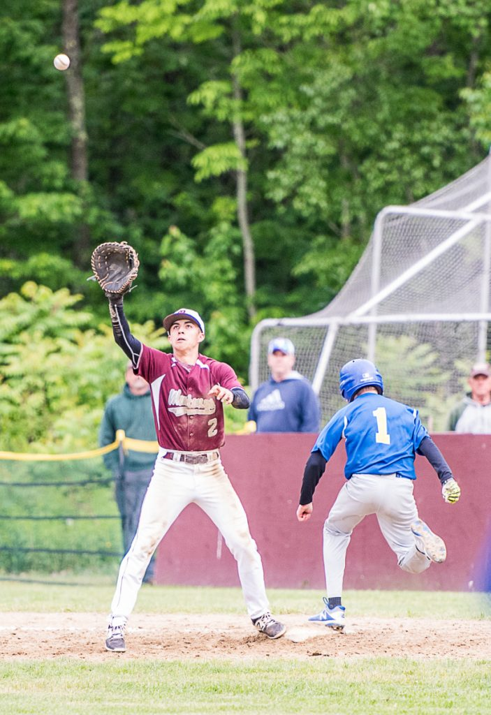 Monmouth Academy's Avery Pomerleau forces an out on Mt. Abram's Kenyon Pillsbury in the last inning of Tuesday afternoon's Class C South prelim game in Monmouth.