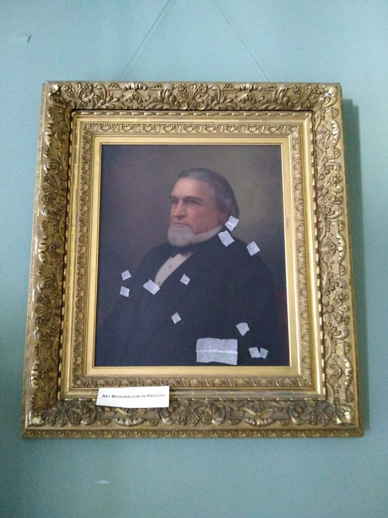 An 1885 oil portrait of Cadwallader Colden Washburn by professional portrait artist William F. Cogswell will be the first painting restored with funds from GeneralMills. Bandages keep flaking paint in place and prevent further damage.