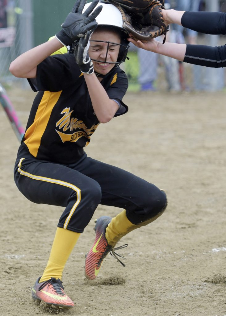 Staff photo by Andy Molloy   Hall-Dale's Sarah Benner doesn't get the tag on time on Maranacook's Abby Jacques at home plate during a Class C South game Wednesday in Farmingdale.