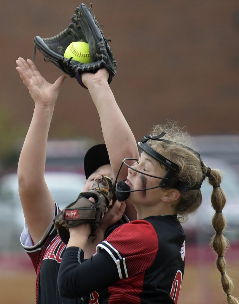 Staff photo by Andy Molloy   Hall-Dale's Sarah Benner, right, and Grace Begin collide collecting a pop up hit by a Maranacook batter during a Class C South prelim game Wednesday in Farmingdale.