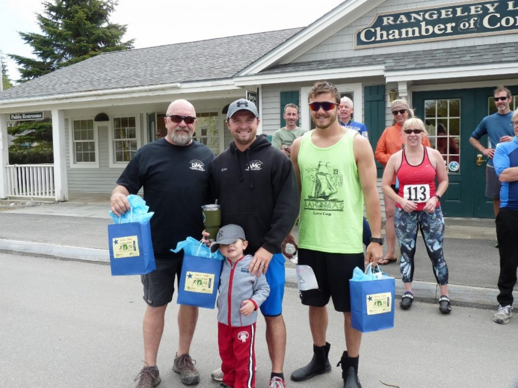 The Team winner of the Rangeley RuKaBi race was Bald Mountain Camps. From left are Steve Philbrick, Tyler Philbrick and Quinn Philbrick. Maxten Philbrick, son of Tyler Philbrick, is in front.