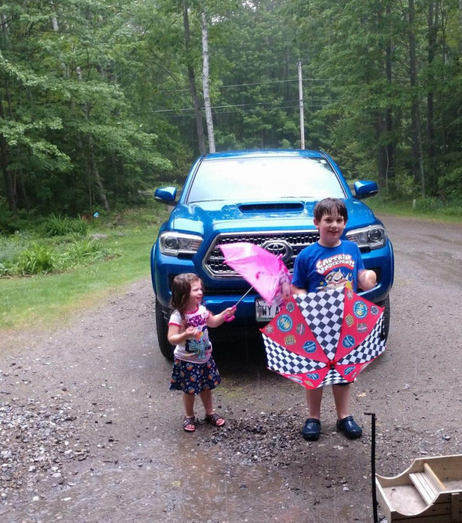 Mikaela Pollard, 2   and Wyatt Pollard, 7, enjoy a recent rainy day at the home of their grandparents' Chris and Janet Weeks, of Oakland. Their grandparents said Wyatt and Mikaela wouldn't let the rain stop them from having fun. Here they are singing and dancing in the down pour!