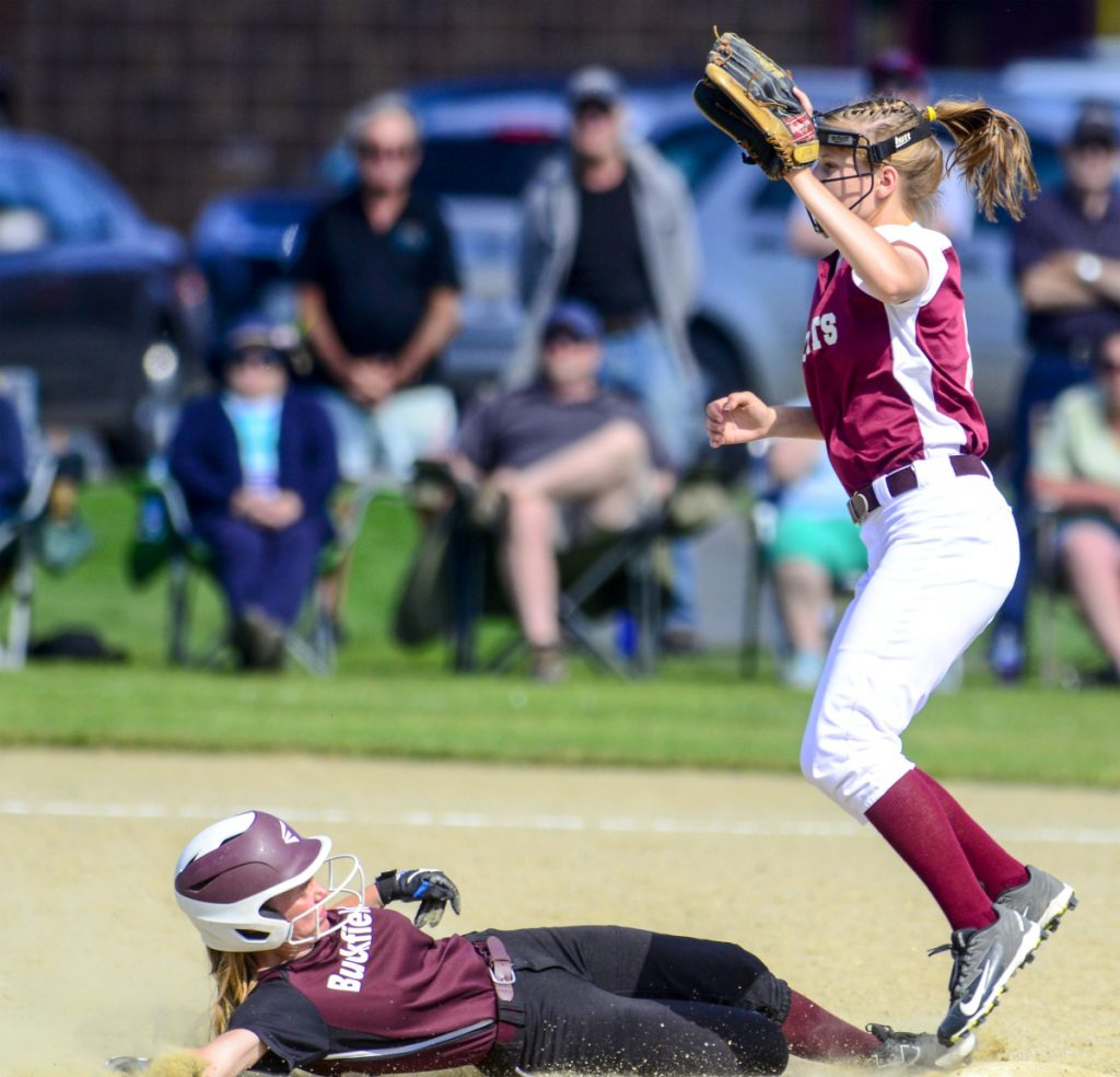 Buckfield baserunner Margaret Bragg was safe at second in front of Richmond shortstop Caitlin Kendrick during a Class D South semifinal game Friday at Richmond High School.