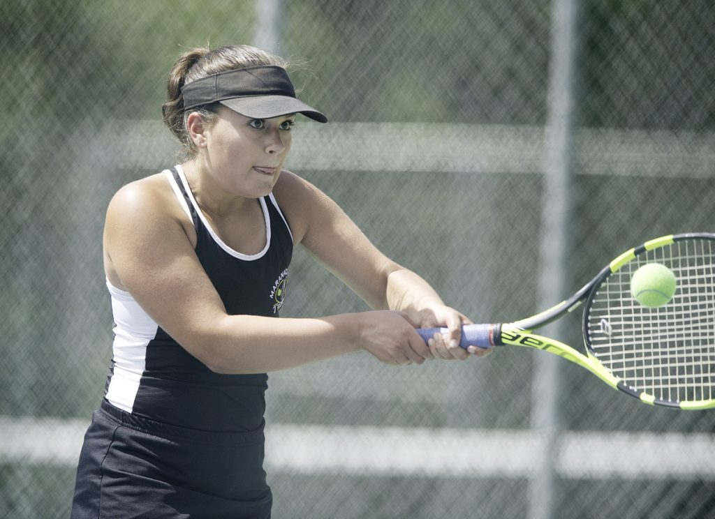 Maranacook No. 2 singles player Emma Wadsworth returns a shot during  the Class C state championship match against Mattanawcook on Saturday in Lewiston.