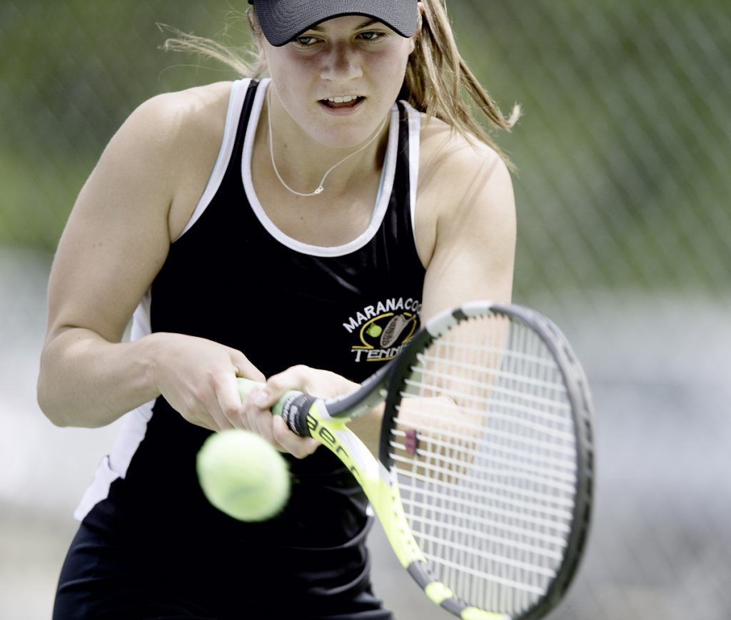 Maranacook No. 1 singles player Madelyn Dwyer returns a shot during  the Class C state championship match against Mattanawcook on Saturday in Lewiston.
