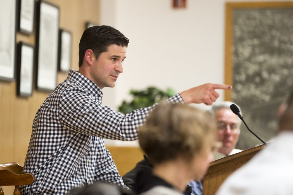 Mayor Nick Isgro points to City Manager Mike Roy, interrupting him after having asked Roy to clarify a proposed outdoor dining ordinance during a budget meeting Tuesday at a City Council chamber at The Center in Waterville.