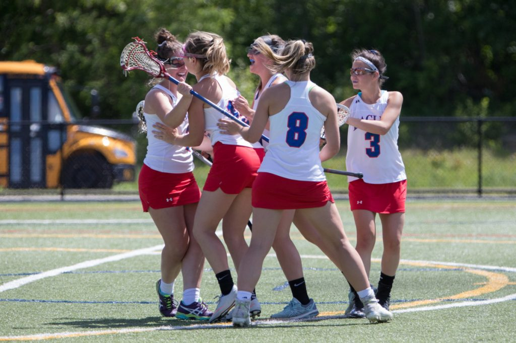 Messalonskee girls lacrosse players celebrate after they went up on Biddeford in a Class B playoff game Saturday at Thomas College.