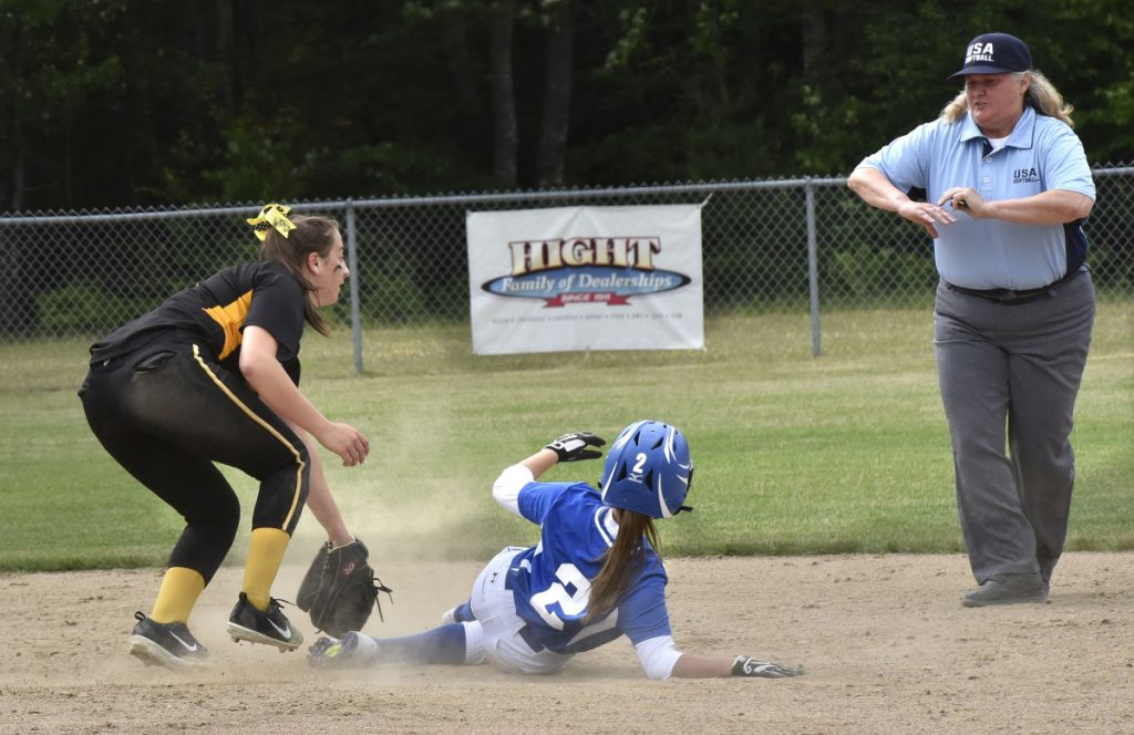 Maranacook shortstop Amanda Goucher looks to an umpire for a call after Madison baserunner Annie Worthen slides safely into second base during a Class C South quarterfinal game Thursday in Madison.