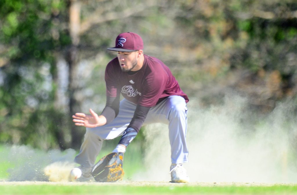 Staff photo by Joe Phelan Richmond shortstop Matt Rines fields a grounder in the dust during a Class D South semifinal game Friday at Richmond High School.