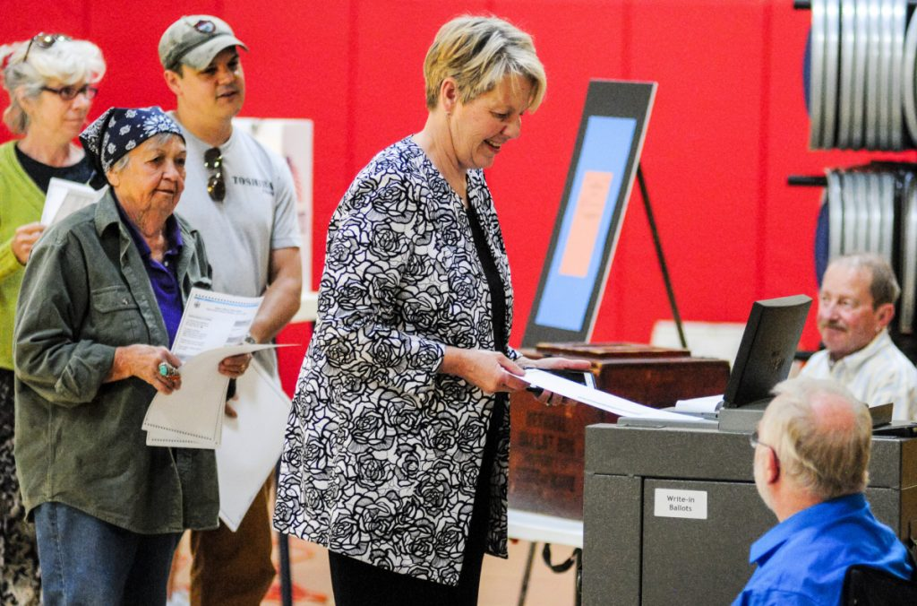 Democratic gubernatorial candidate Betsy Sweet casts her ballot on Tuesday in Hall-Dale Elementary School gym in Hallowell. Sweet said that she voted for herself first and Mark Eves second, but kept the rest of her choices on the ranked choice primary ballot private.
